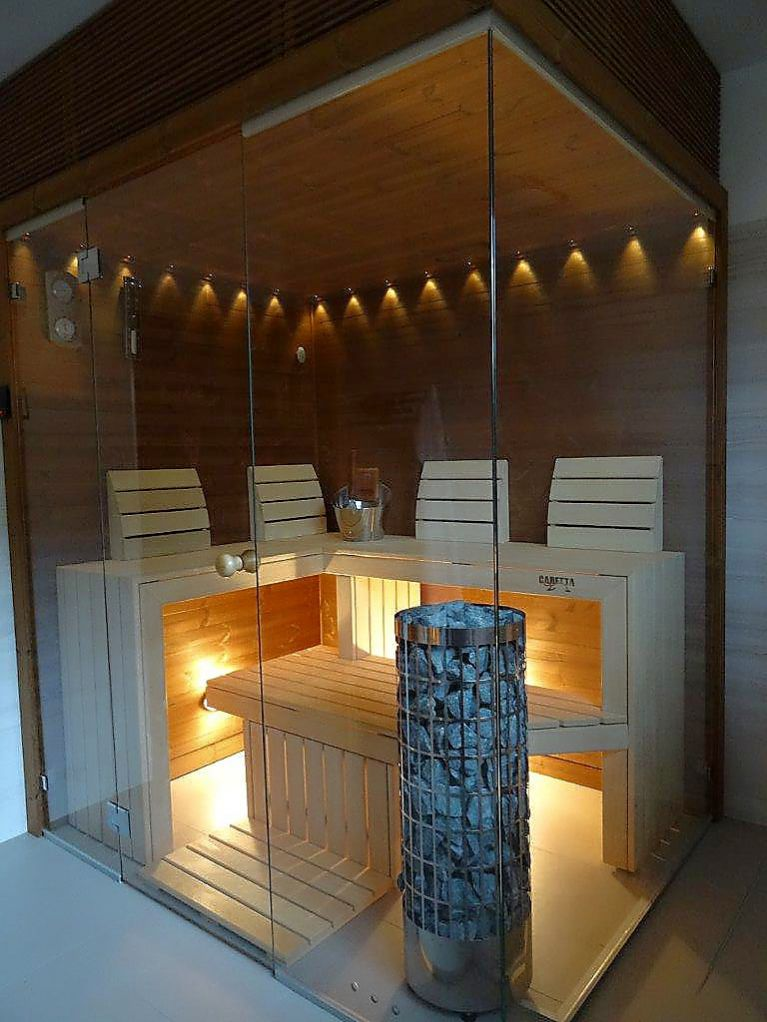 Corner finnish sauna with Thermowood interior and Caritti lights